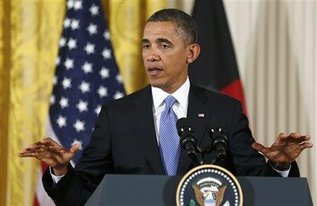 President Barack Obama addresses a joint news conference with Afghan President Hamid Karzai in the East Room of the White House in Washington, January 11, 2013. REUTERS/Larry Downing