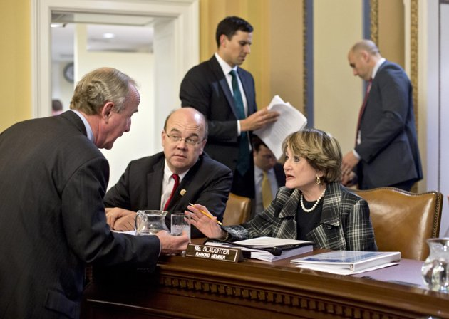 Rep. Rodney Frelinghuysen, R-N.J., left, confers with Rep. Louise Slaughter, D-N.Y., Rep. Jim McGovern, D-Mass., center, as the House Rules Committee sorts through dozens of amendments on an aid package to assist victims of Superstorm Sandy that devastated parts of the Northeast coast in October, at the Capitol in Washington, Monday, Jan. 14, 2013. The House is expected to vote on the bill Tuesday.  (AP Photo/J. Scott Applewhite)