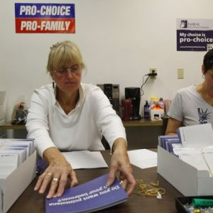 "NARAL Pro-Choice New Hampshire volunteer Gail Laker-Phelps (L) and NARAL Pro-Choice New Hampshire Campaign Director Melissa Bernardin put address labels mailers which read, ""Do you want politicians in your bedroom?"" in Concord, New Hampshire October 27, 2012.  REUTERS/Jessica Rinaldi"