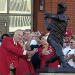 "In this Oct. 1, 2006, file photo, St. Louis Cardinals great Stan ""The Man"" Musial strikes his signature pose after unveiling his statue at the re-dedication ceremony for the statues, at the new Busch Stadium, of Cardinals Hall-of- Famers and notables before a baseball game against the Milwaulkee Brewers in St. Louis. Musial, one of baseball's greatest hitters and a Hall of Famer with the St. Louis Cardinals for more than two decades, died Saturday, Jan 19, 2012, the Cardinals announced. He was 92.  (AP Photo/Tom Gannam, File)"