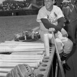 In this May 13, 1958 file photo, Stan Musial, St. Louis Cardinal all-time great baseball player, poses in dugout prior a baseball game against the Chicago Cubs in Chicago. Musial made his 3,000th career hit in the game. Musial, one of baseball&#039;s greatest hitters and a Hall of Famer with the Cardinals for more than two decades, died Saturday, Jan. 19, 2013, the team announced. He was 92. 