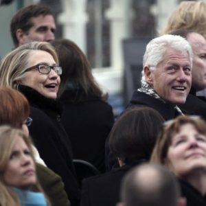 Secretary of State Hillary Rodham Clinton and former president Bill Clinton look on during the ceremonial swearing-in ceremony during the 57th President Inauguration, Monday, Jan. 21, 2013, on the West Front of the Capitol in Washington.  (AP Photo/Win McNamee, Pool)
