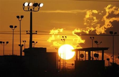 The sun rises over the U.S. detention center Camp Delta at US Naval Base Guantanamo Bay in Cuba on October 18, 2012 in this photo reviewed by the U.S. Department of Defense.  (REUTERS/Michelle Shephard/Pool)