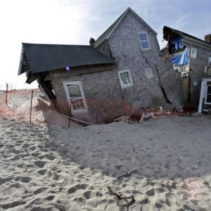 In this Jan. 3, 2013 photo, a beach front home that was severely damaged by Superstorm Sandy rests in the sand in Bay Head, N.J.  (AP Photo/Mel Evans)