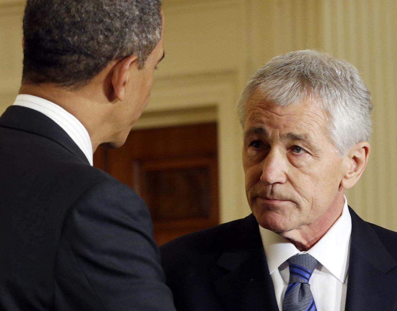 Chuck Hagel with President Obama (AP Photo/Carolyn Kaster, File)