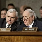 Senate Armed Services Committee Chairman Sen. Carl Levin, D-Mich., right, talks with committee member Sen. Jack Reed, D-R.I., during the the committee's confirmation hearing for former Nebraska Republican Sen. Chuck Hagel, President Obama's choice for defense secretary, on Capitol Hill in Washington. Levin said Friday he will press ahead with a vote on Hagel's nomination to be defense secretary, rejecting Republicans demands for more financial information from President Barack Obama's choice as setting an unprecedented new standard. (AP Photo/J. Scott Applewhite, File)