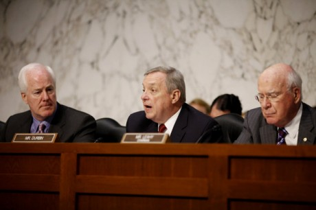 "Sen. Richard Durbin, D-Ill., center, flanked by Sen. John Cornyn, R-Texas, left, and Sen. Patrick Leahy, D-Vt., speaks during a meeting on Capitol Hill in Washington. The Senate holds its second hearing Tuesday, Feb. 12, 2013, on gun curbs since the December 2012 shooting deaths of 20 first-graders in Newtown, Conn. This time, a Senate Judiciary subcommittee is examining the constitutionality and effectiveness of federal firearms limits. ""We need to keep guns out of the hands of criminals and those who are mentally unstable,"" Durbin, D-Ill., said in a brief interview Monday, Feb. 11, 2013. ""I hope everyone will acknowledge what within our Constitution is not only an individual right to bear arms, but the collective right of Americans to be safe.""  (AP Photo/Charles Dharapak, File)"