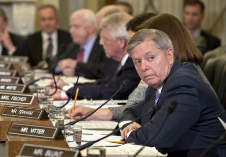 Sen. Lindsey Graham, R-S.C., waits to make a statement in opposition to President Barack Obama's choice of former Nebraska Sen. Chuck Hagel to run the Pentagon as a bitterly divided Senate Senate Armed Services Committee considers the nomination on Capitol Hill in Washington. On a talk show Sunday, Feb. 17, 2013, Graham said critics were &quot;doing our job to scrutinize ... one of the most unqualified, radical choices for secretary of defense in a very long time.&quot;  (AP Photo/J. Scott Applewhite, File)