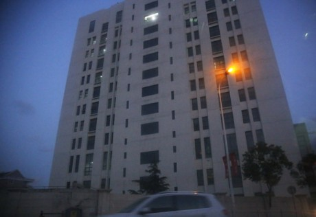 "The building housing ""Unit 61398"" of the People's Liberation Army is seen in the outskirts of Shanghai, Tuesday Feb. 19, 2013. Cyberattacks that stole information from 141 targets in the U.S. and other countries have been traced to the Chinese military unit in the building, a U.S. security firm alleged Tuesday. According to the report by the Virginia-based Mandiant Corp., it has traced the massive amount of hacking back to the 12-story office building run by ""Unit 61398"", and that the attacks targeted key industries including military contractors and companies that control energy grids. China dismissed the report as ""groundless.""(AP Photo)"