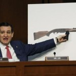 Senator Ted Cruz, (R-TX), holds a plastic hand grip in front of a picture of a hunting rifle as he questions NRA CEO Wayne LaPierre (not in photo) about the effect of proposed gun control legislation during a hearing held by the Senate Judiciary committee on Capitol Hill in Washington January 30, 2013.(REUTERS/Kevin Lamarque)