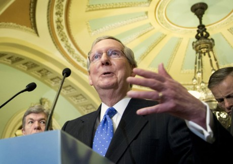 Senate Republican Leader Sen. Mitch McConnell, R-Ky., talks to reporters on Capitol Hill in Washington. In Kentucky next year McConnell is gearing up for a tough re-election fight, and trying to prevent one. He's trying to head off a GOP primary challenge by cozying up to the tea party, and trying to scare off potential Democratic contenders, like actress Ashley Judd, by giving all a glimpse of his no-holds-barred political tactics. (AP Photo/Manuel Balce Ceneta, File)