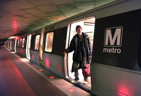A passenger gets off a red-line train at the Farragut North Metro Station in Washington. For decades, the economy in and around the Capital Beltway has benefited from the growth of the federal government. Now, as automatic federal budget cuts kick in, those same communities are bracing to take a disproportionate hit. (AP Photo/Susan Walsh, File)
