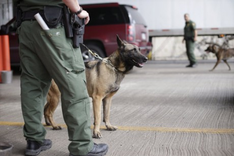 U.S. Customs and Border Patrol agents and K-9 security dogs keep watch at a checkpoint station, Friday, Feb. 22, 2013, in Falfurrias, Texas. Government agencies vary widely in how they are dealing with $85 billion in across-the-board budget cuts that went into effect last week. Federal workers could face seven days of furloughs at the Housing and Urban Development Department, but Homeland Security personnel might see twice that number.  (AP Photo/Eric Gay)