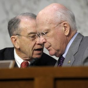 Senate Judiciary Committee Chairman Sen. Patrick Leahy, D-Vt., right, talks with the committee's ranking Republican Sen. Charles Grassley, R-Iowa, on Capitol Hill in Washington. (AP Photo/Susan Walsh, File)