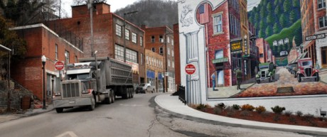 A coal truck drives out of downtown Welch, W.Va.  (AP Photo/Jon C. Hancock, File)