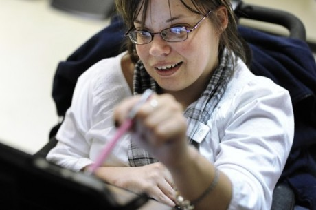 Jennifer Lortie works on an iPad in her Willimantic, Conn. office.  (AP Photo/Jessica Hill)