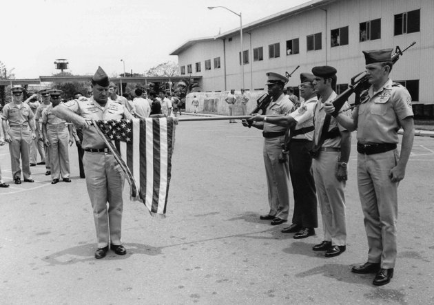 In this March 29, 1973 file photo, the American flag is furled at a ceremony marking official deactivation of the Military Assistance Command-Vietnam (MACV) in Saigon, after more than 11 years in South Vietnam. While the fall of Saigon in 1975 — with its indelible images of frantic helicopter evacuations — is remembered as the final day of the Vietnam War, March 29 marks an anniversary that holds greater meaning for many who fought, protested or otherwise lived the war.  (AP Photo/Charles Harrity, File)