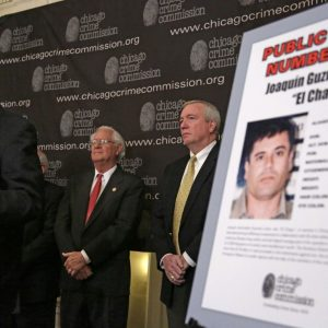 Art Bilek, executive vice president of the Chicago Crime Commission, left, announces that Joaquin ``El Chapo'' Guzman, a drug kingpin in Mexico, has been named Chicago's Public Enemy Number One (AP Photo)