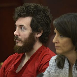 James Holmes, left, and defense attorney Tamara Brady appear in district court in Centennial, Colo. for his arraignment. Court documents are raising new questions for the university that Colorado theater shooting suspect James Holmes attended before the July 20 theater shooting that left 12 people dead and 70 injured.  (AP Photo/The Denver Post, RJ Sangosti, Pool, File