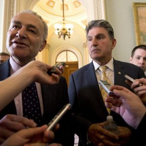 Sens. Chuck Schumer, D-N.Y., left, and Joe Manchin, D-W.Va. speak to reporters as they walk from Senate Majority Leader Harry Reid's, D-Nev., office on Capitol Hill in Washington, Tuesday, April 9, 2013, after a meeting on gun control. Reid's determination to stage a vote came despite continued inconclusive talks between Manchin, Sen. Patrick Toomey, R-Pa., aimed at finding compromise on expanding background checks to more gun purchasers. But Manchin left a meeting in Reid's office late Tuesday and said he hoped a deal could be completed on Wednesday. (AP Photo/Manuel Balce Ceneta)