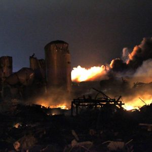 The remains of a fertilizer plant burn after an explosion at the plant in the town of West, near Waco, Texas early April 18, 2013. The deadly explosion ripped through the fertilizer plant late on Wednesday, injuring more than 100 people, leveling dozens of homes and damaging other buildings including a school and nursing home, authorities said. REUTERS/Mike Stone