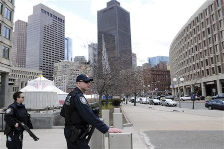 Federal Homeland Security police officers stand guard at Government Center in Boston, Massachusetts, April 19, 2013, as the manhunt continues for Dzhokar Tsarnaev, the remaining suspect in the Boston Marathon bombings. REUTERS/Neal Hamberg