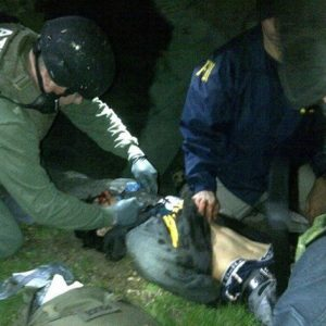 ATF and FBI agents check Boston Marathon bombing suspect Dzhokhar Tsarnaev for explosives and also give him medical attention after he was apprehended in Watertown, Mass. The Nielsen company said nearly 42 million people watched the last hour of Friday's manhunt for Tsarnaev on television.