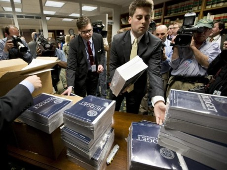 Copies of President Barack Obama's budget plan for fiscal year 2014 are distributed to Senate staff on Capitol Hill in Washington. (AP Photo/J. Scott Applewhite, File)