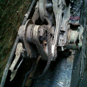 Friday, April 26, 2013, photo provided by the New York City Police Department shows a piece of landing gear that authorities believe belongs to one of the airliners that crashed into the World Trade Center on Sept. 11, 2001, that was found wedged between a mosque and another building, in New York. Police say the medical examiner's office will complete a health and safety evaluation to determine whether to sift the soil around the buildings for possible human remains. (AP Photo/New York City Police Department)