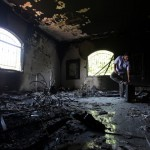 a Libyan man investigates the inside of the U.S. Consulate after an attack that killed four Americans, including Ambassador Chris Stevens, on the night of Tuesday, Sept. 11, 2012, in Benghazi, Libya.  (AP Photo/Mohammad Hannon, File)