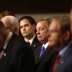 Sen. Marco Rubio, R-Fla., center, and others Senators, participate in a news conference on immigration on Capitol Hill in Washington. From left are, Sen. Charles Schumer, D-N.Y., Sen. John McCain, R-Ariz., Sen. Jeff Flake, R-Ariz., Rubio, Senate Majority Whip Richard Durbin of Ill., and Sen. Robert Menendez, D-N.J.  (AP Photo/Charles Dharapak