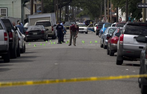 Madman with a gun wounds 19 in Mothers Day parade