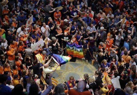 People fill the Minnesota State Capitol as they waited for word that the Senate had passed the gay marriage bill Monday, May 13, 2013 in St. Paul, Minn. The bill now goes to the governor who is expected to sign it. (AP Photo/Jim Mone)