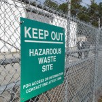 "A sign cautions visitors outside a ""pump and treat"" facility on the Marine base at Camp Lejeune, N.C. The sprawling installation is the site of one of the worst drinking water contaminations in U.S. history. (AP Photo/Allen Breed)"