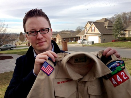 "Wes Comer holds the Boy Scout uniform of his son, Isaiah, outside their home in Knoxville, Tenn. Comer, whose family attends an Apostolic Pentecostal church which considers homosexuality sinful, had been wrestling with whether to pull his eldest son out of the Scouts if the no-gays policy was abandoned. ""To be honest, I'm torn at this point,"" Comer said in an e-mail Friday, May 24, 2013. ""I'm not sure exactly what our decision will be."" ""If I place this situation in the context of my religious beliefs, I'm forced to ask myself, 'Would I turn a homosexual child away from Sunday School? From a church function? Would I forbid my children to be friends with a gay child?' I can't imagine a situation where I would answer 'yes' to any of those questions. So how can I in this one?"" he wrote."