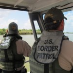 Border Patrol agents Henry Davis and Arturo Vela patrol the Rio Grande by boat.
