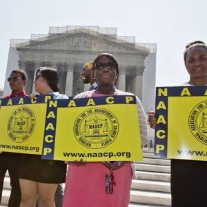 Demonstrating at the Court (AP Photo/J. Scott Applewhite, File)