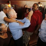 Vice President Joe Biden uses a phone to take a photo of himself and a patron of Croaker's Spot, a local restaurant in Richmond, Va. on Saturday.  (AP Photo/The Richmond Times-dispatch, Joe Mahoney)