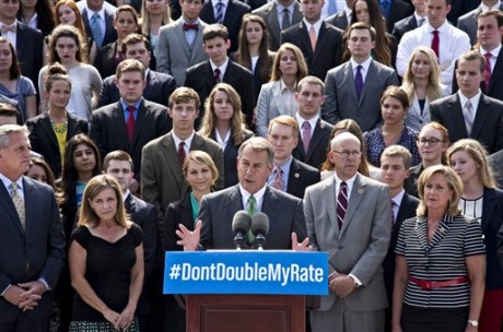 With a backdrop of college students on the step of the House of Representatives, Speaker of the House John Boehner, R-Ohio, center, and GOP leaders talk about the politics of federal student loan rates which doubled on July 1, at the Capitol in Washington, Monday, July 8, 2013. (AP Photo/J. Scott Applewhite)