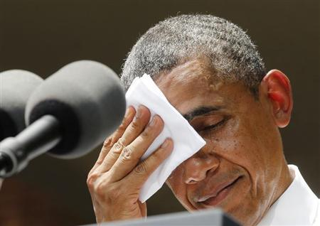 U.S. President Barack Obama pauses and wipes his face as he speaks about his vision to reduce carbon pollution while preparing the country for the impacts of climate change while at Georgetown University in Washington. REUTERS/Larry Downing