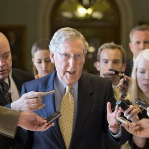 Senate Republican Leader Mitch McConnell of Kentucky is surrounded by reporters as he returns to his office after meeting with Senate Majority Leader Harry Reid, D-Nev., at the Capitol in Washington, Monday, July 15, 2013. The Senate Democrats that make up the majority and the Republicans that comprise the minority are gathering in a rare closed-door meeting in the Old Senate Chamber for a showdown over presidential nominees that have been blocked by a GOP filibuster. (AP Photo/J. Scott Applewhite)