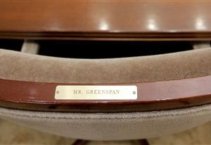 FILE - In this Tuesday Jan. 25, 2005, file photo, a nameplate is affixed to the chair of US Federal Reserve Board Chairman Alan Greenspan in the main meeting room of the Board of Governors of the Federal Reserve System in Washington. The White House says Friday, July 26, 2013, that President Barack Obama is not expected to name a new chairman of the Federal Reserve until the fall, lowering expectations for an imminent announcement.  (AP Photo/Lawrence Jackson,File)
