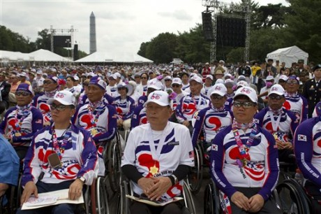 A group from the Paralyzed Veterans of Korea watch as President Barack Obama speaks on the 60th anniversary of the end of the Korean War, during remarks at a commemorative ceremony near the Korean War Veterans Memorial on the National Mall in Washington, on Saturday, July 27, 2013. (AP Photo/Jacquelyn Martin)