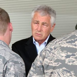 Secretary of Defense Chuck Hagel chats with Air Force personnel Wednesday, July 17, 2013, at Joint Base Charleston near Charleston, S.C. Hagel was on the third day of a three-day trip to visit bases in the Carolinas and Florida. He told civilian Department of Defense workers that, if the department has to absorb another $52 billion in cuts next year because of the federal sequester, there will likely be layoffs instead of furloughs. (AP Photo/Bruce Smith)