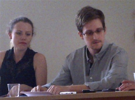 NSA leaker Edward Snowden, center, attends a news conference at Moscow's Sheremetyevo Airport with Sarah Harrison of WikiLeaks, left, Friday. The whole time Snowden has been seeking asylum,  (AP Photo/Human Rights Watch, Tanya Lokshina, File)