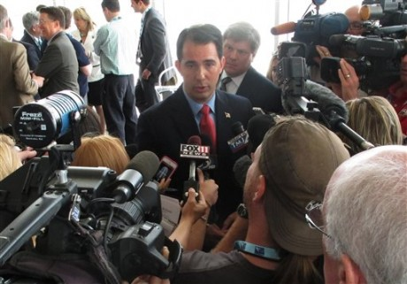 Wisconsin Gov. Scott Walker draws the biggest crowd of reporters following a news conference on the opening day of the National Governors Association meeting on Friday, Aug. 2, 2013, in Milwaukee, Wis. (AP Photo/Scott Bauer)