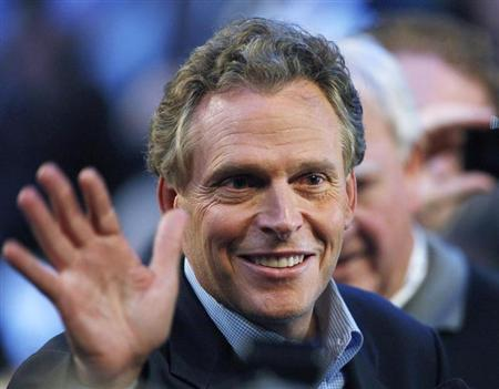 Terry Mcauliffe waves at the 2008 Democratic National Convention in Denver
