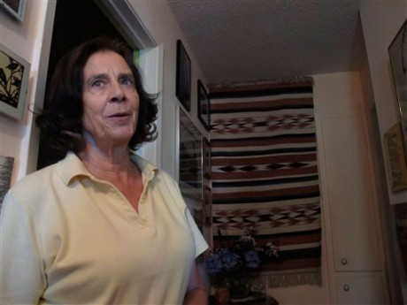 Maria Varela, 73, recollects her role in the Civil Rights movement in Alabama and Mississippi, at her home in Albuquerque, N.M.  (AP Photo/Russell Contreras)