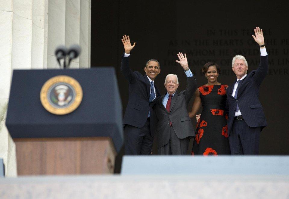 President Barack Obama, former President Jimmy Carter, First Lady Michelle Obama and former President Bill Clinton. (AP/Evan Vucci)