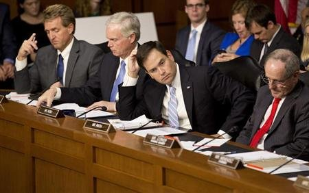 Republican Senators Jeff Flake, Ron Johnson, Marco Rubio and James Risch.  Now what? (Reuters/Joshua Roberts)